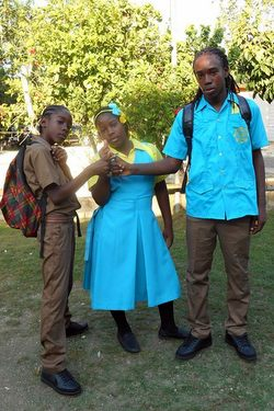 Makiva (center) her big brother Zion (right), and a fellow student ready for school.