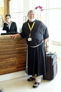 Fr. Jeff is happy to finally get his lost luggage and return his borrowed habit that is much too short! Photo: ©capitulumgenerale2015