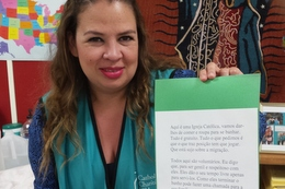 "Volunteer Mayra Garza with a language ""cheat sheet"""