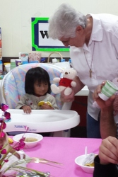 Sr. Anita Jennissen offers a stuffed animal as a comfort.