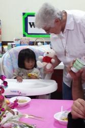 Sr. Anita Jennissen offers a stuffed animal as a comfort.