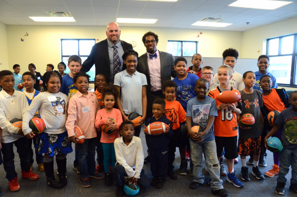 Cincinnati Bengal's Andrew Whitworth and Dhani Jones signed footballs for the Friars Club Kids.