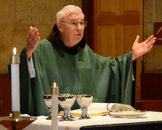 Fr. Jeremy, 85, Associate Pastor at Church of Transfiguration, Southfield, MI, presiding at Mass.