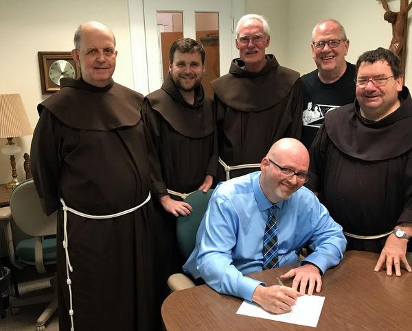 Friars and postulant Tim