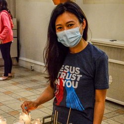 young woman lighting candle