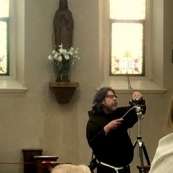 friar with camera
