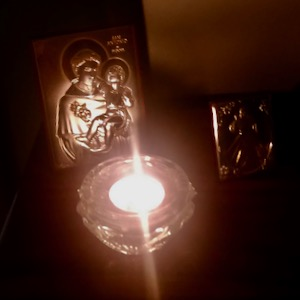 candle and St. Anthony plaque