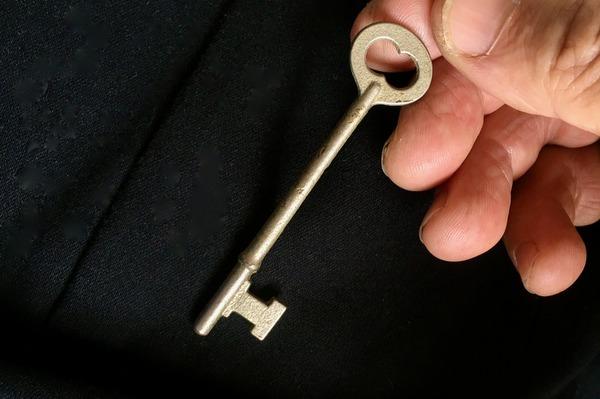 man pulling key out of pocket