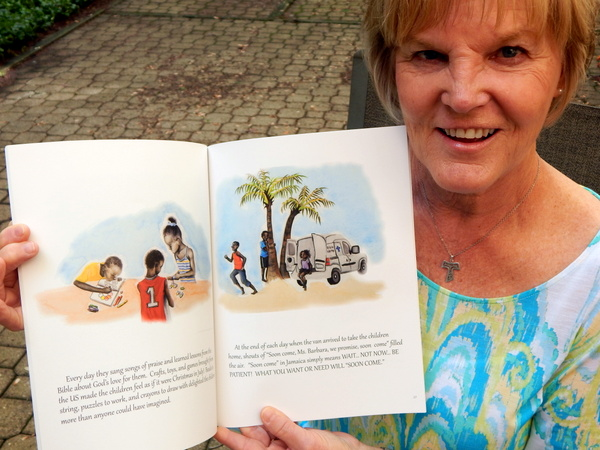 "Author Barb Coyle holds her book, ""In the Land of ""Soon Come"" illustrated by 14-year-old Taylor Kling."