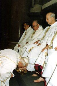 Pope John Paul II washing the feet of Fr. Cyprian