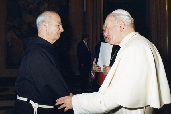 Fr. Cyprian Berens, OFM, greets Pope John Paul II in 1989