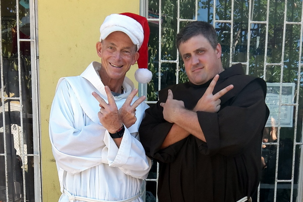 Fr. Jim Bok and Fr. Colin King at the St. Anthony's Kitchen Christmas Party