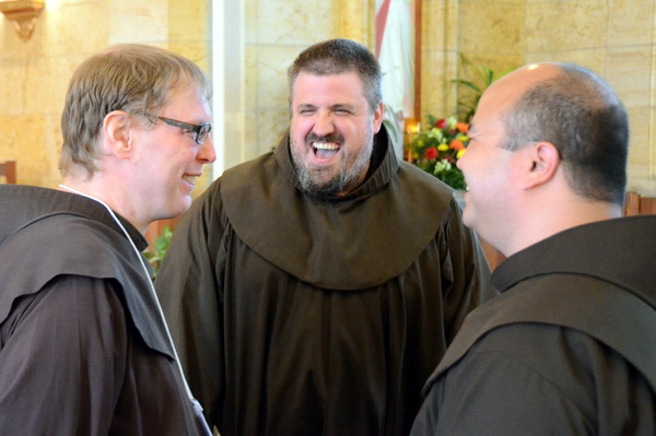 Br. Michael Charron enjoys a good laugh with fellow friars Br. Colin King and Fr. Roger Lopez