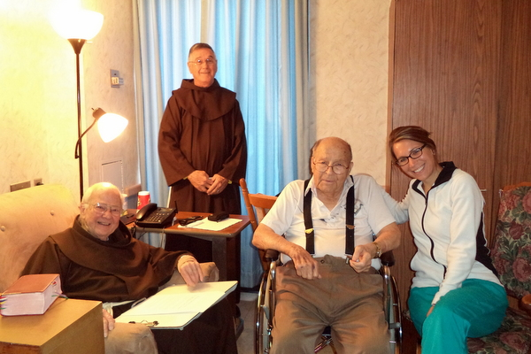 Br. Norbert Bertram (standing) visits friars Cyprian Berens, Valens Waldschmidt and their nurse at Little Sisters of the Poor