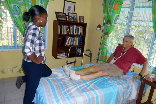 Physical therapist Ms. Addiman assesses Fr. Jim's situation.