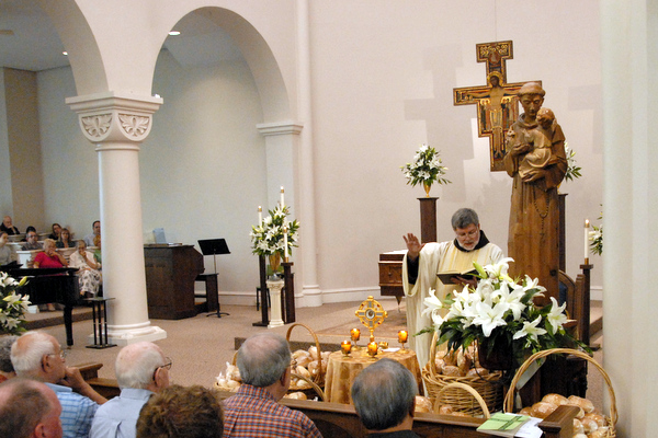 Fr. Jeff Scheeler, OFM, blesses the St. Anthony Bread at the National Shrine of St. Anthony of Padua in Cincinnati.