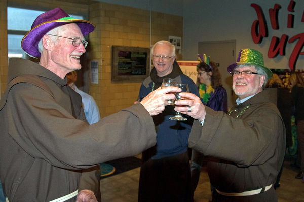 Friars Frank Jasper, Al Hirt, and Jeff Scheeler toast the release of St. Anthony's Quad Beer