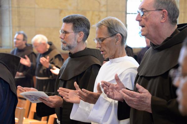 Friars praying in church