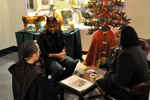 Br. Michael Radomski, OFM, chats with a couple.