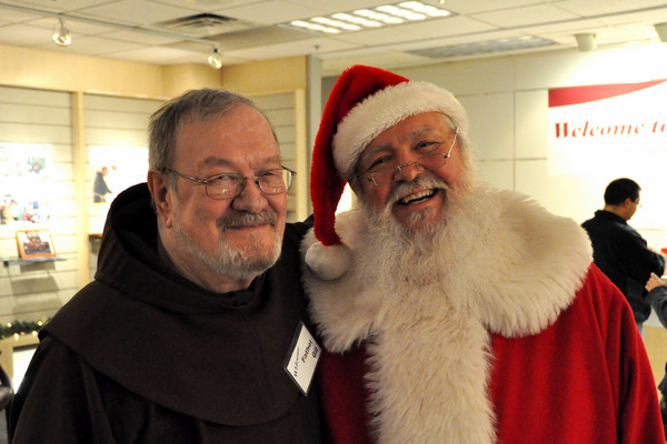 Fr. Gil Wohler, OFM, with Santa Claus at Northgate Mall during 'Advent with the Franciscans'
