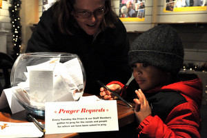 A young visitor writes a prayer request