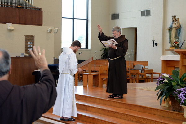 Fr. Richard Goodin, OFM, receives a blessing from Provincial Minister Fr. Jeff Scheeler, OFM, and the congregation