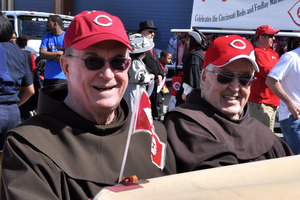 Fr. John Bok, OFM, & Fr. Blane Grein, OFM, ride in the rumble seat of a 1930 Ford Model A Roadster courtesy of Cobb Car Care