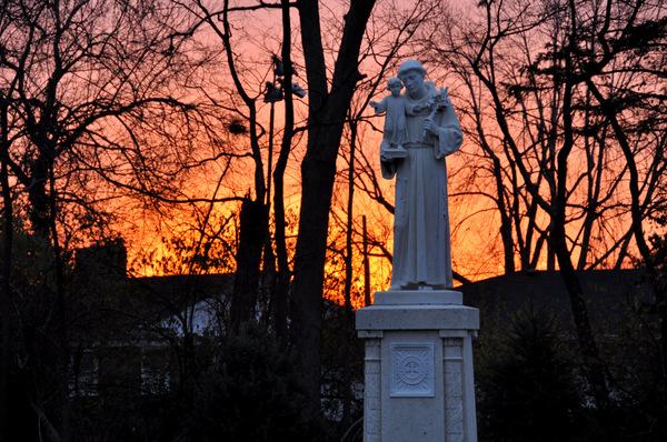 St. Anthony Statue and sunrise