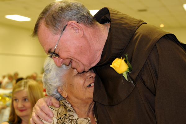 Fr. John Bok with a parishioner