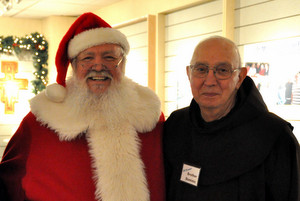 Br. Dominic with Santa Claus at the Northgate Mall ministry last December
