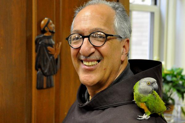 parrot on shoulder of friar