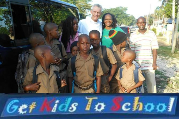 Fr. Jim Bok, OFM, Joan Cooney (Ms. Joans)  and her brother James with students from the 'Get Kids To School' program as they board 'Josey' the van that will take them to school.