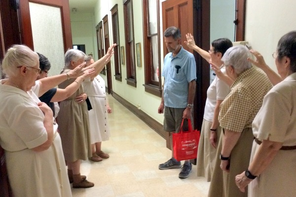 Br. Mark Gehret, OFM, receives a blessing from the New Orleans Poor Clares