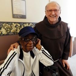 Fr. Don Holtgrewe with parishioner