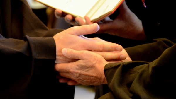 hands held praying