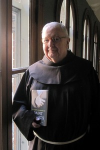 "Fr. Hilarion Kistner, OFM, with his book, ""The Gospels According to Saint Francis"""