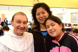 Fr. Joe Hund with parishioners
