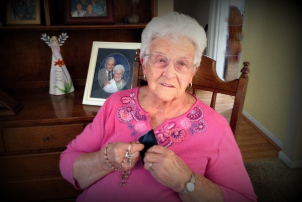 Marian with her special rosary made from the roses from her husband Don's coffin.