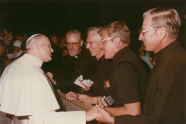 Pope John Paul II meets the four Schneider brothers, all Franciscan priests: Aquinas, Bernardin, Ric, and Chris.