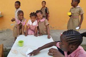 children clean-up breakfast