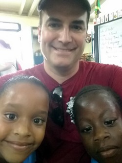 Br. Matt with children in Jamaica in 2018