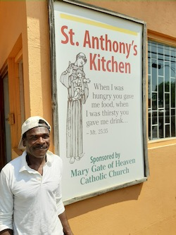 man and St. Anthony sign