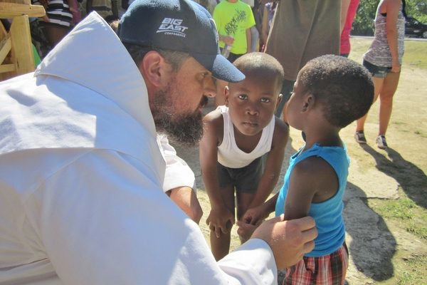 friar with children in Jamaica