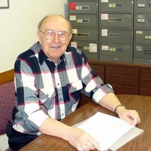 Fr. Bruno at a desk