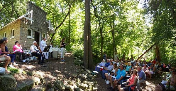 Mass in the woods outside St. Anthony Chapel