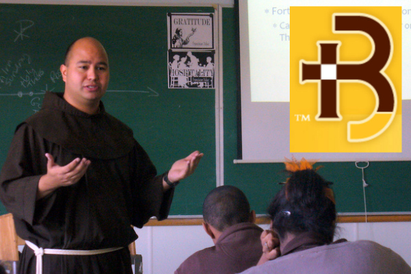 Fr. Roger Lopez, OFM, in the classroom at Roger Bacon, H. S.