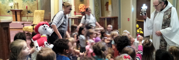 Fr. David Moczulski, OFM, blesses stuffed animals at Sisters of Charity chapel.