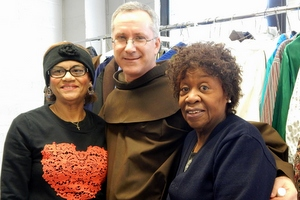 Fr. Alex with helpers at the food pantry clothing outlet