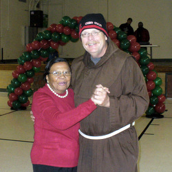 Fr. Dennis Bosse dances with parishioner