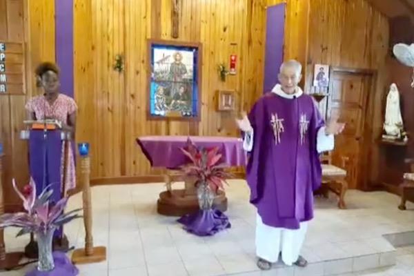 Fr. Jim in church
